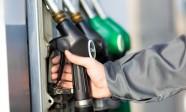 Man holding a fuel nozzle