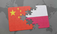 puzzle with the national flag of china and poland on a world map background.